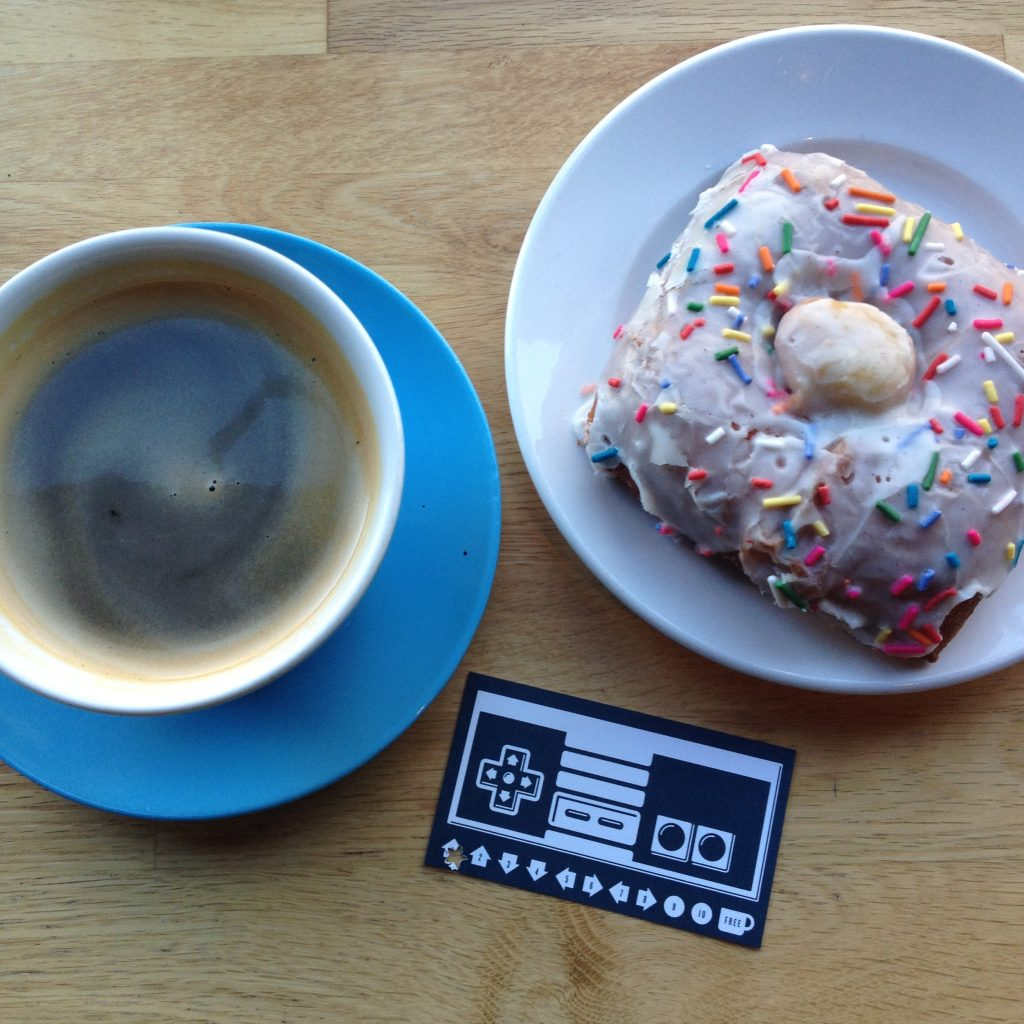 Americano and Fritz Pastry sprinkle doughnut at The Wormhole