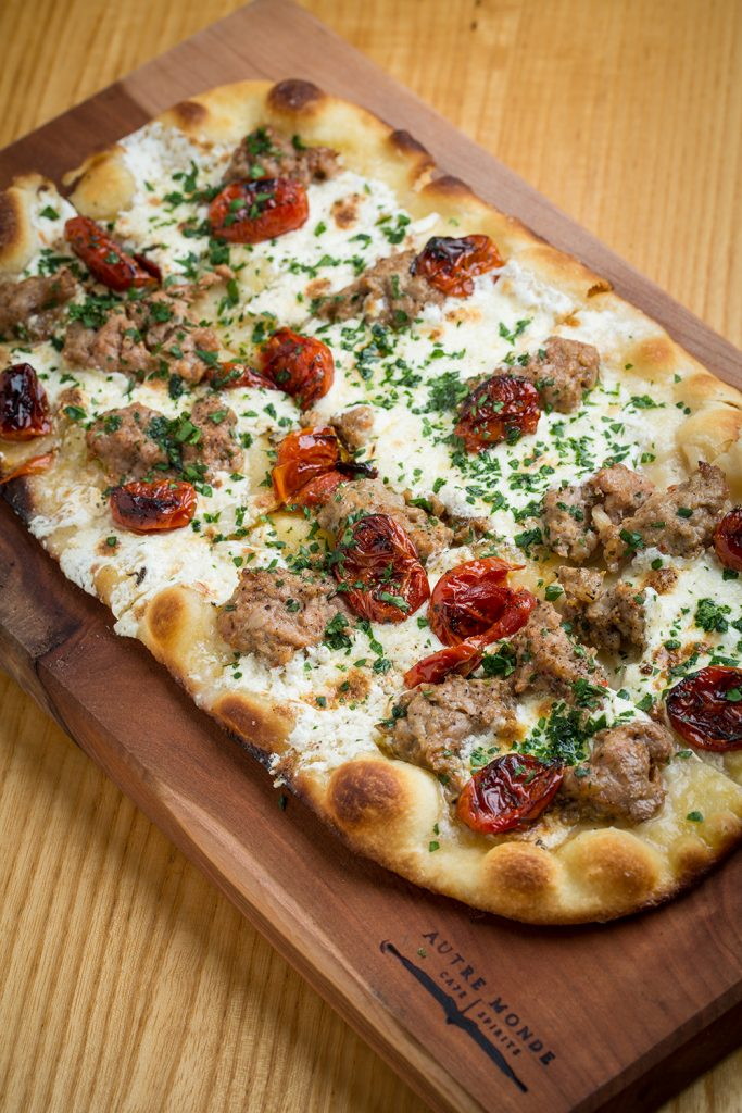 The duck sausage flatbread at Autre Monde with Leah Nolan of the Chicago Chic.