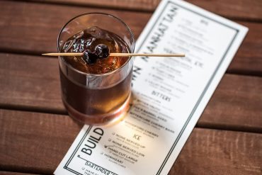This is a craft cocktail review by Leah Nolan of the Chicago Chic featuring the Build Your Own Manhattan at LUXBAR in Chicago.