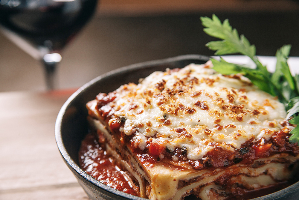 A hearty piece of homemade lasagna from Pinstripes Chicago.